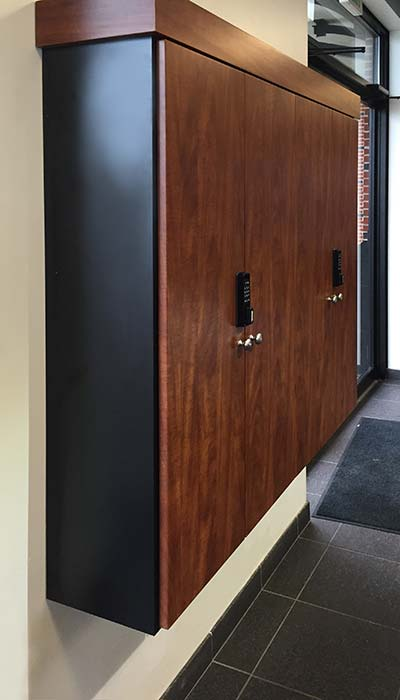 key cabinet for car dealership with wood front and black laminate side panels