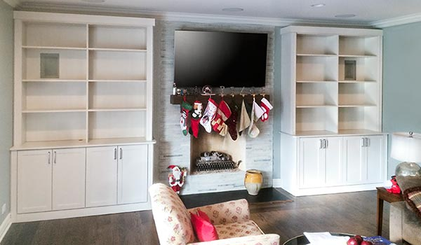 Custom entertainment center surounds fireplace in family room
