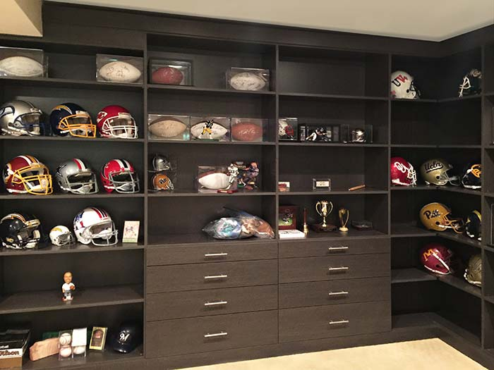 Floor to ceiling shelving for a football fanatic