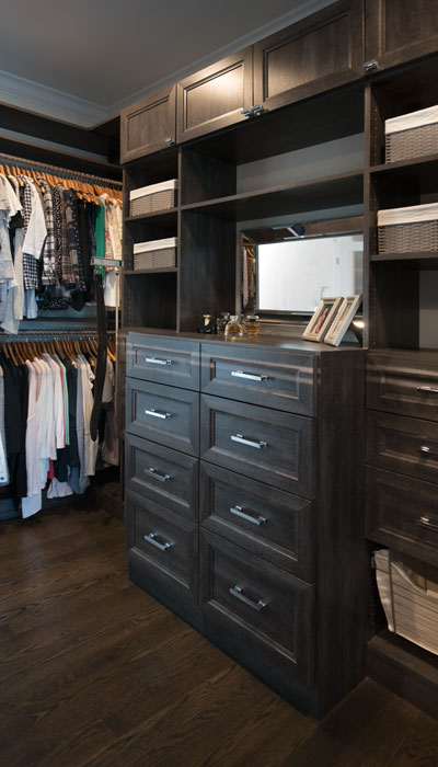 Built-in closet dresser with mirror above it