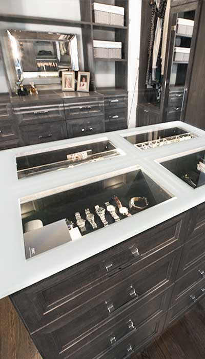closet island with lighted display in countertop