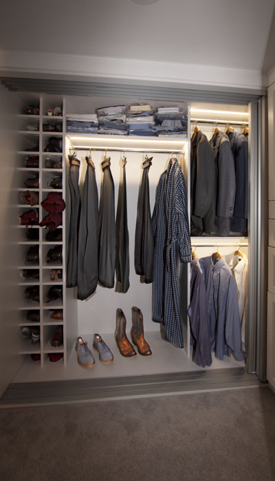 Custom reach-in closet with lighting system.
