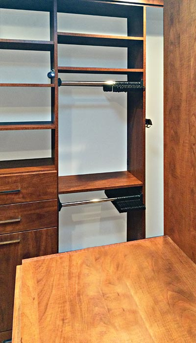 Valet custom closets design with spinning closet organizer pull-outs