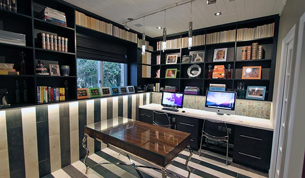 Home office designs with 2 work stations and custom wall unit storage
