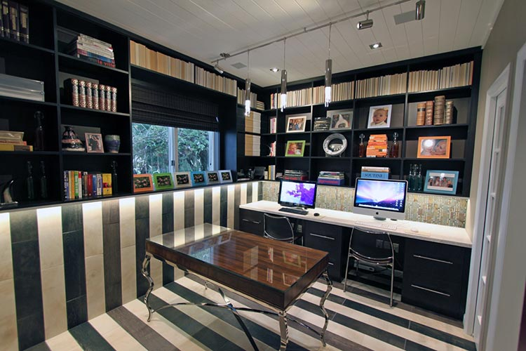Custom home office wall system in black with desk and storage