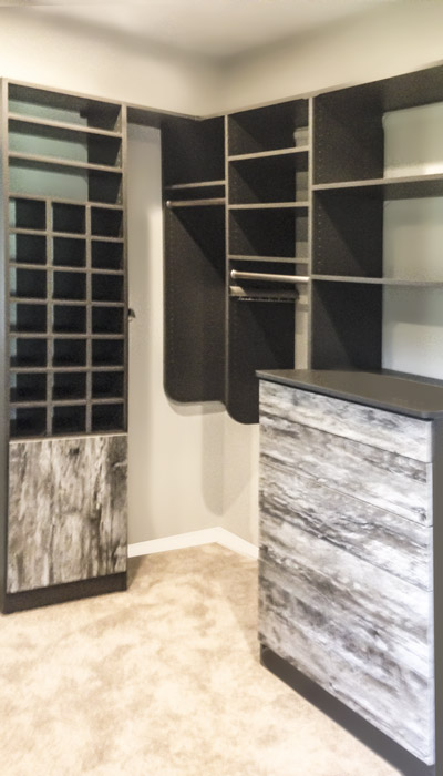 walk-in closet with intrigue panels