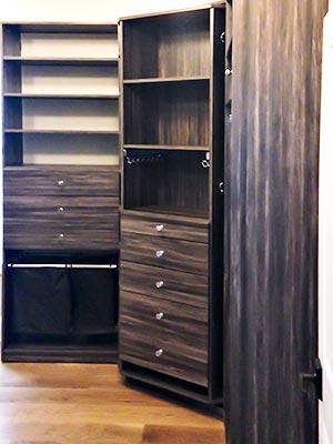 entry hall closet design with triple hanging organization and shoe storage