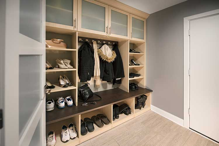 family mudroom custom storage with backpack, coat cubbies and shoe towers
