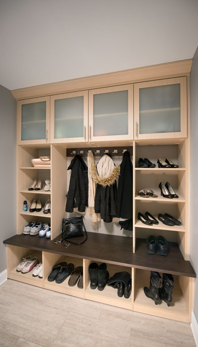 This mudroom provides wheelchair accessible storage.