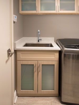 entryway remodel with laundry cabinet organization system
