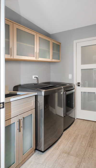 Laundry room cabinets increase storage and maximize efficiency