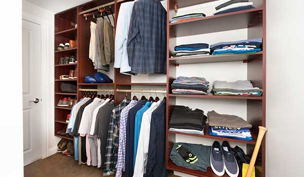Narrow L-shaped walk-in closet