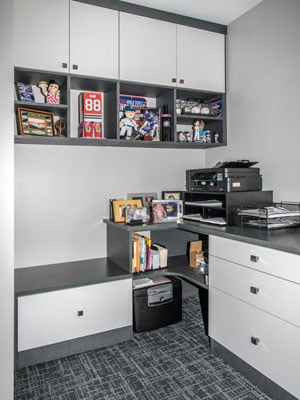 modern home office with memorabilia storage and curved shelving