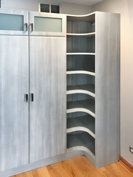 custom entryway organization system with curved shelves