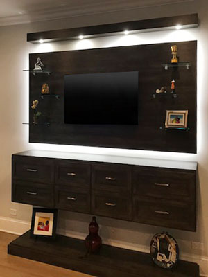 master entertainment center in vintage with glass shelves and led lights