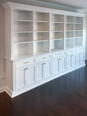 white living room wall unit with cabinets with pull-out shelves