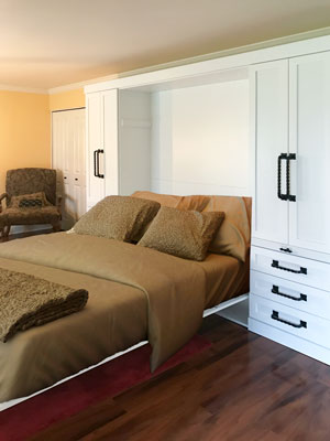 queen sized wall bed with decorative handles