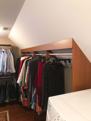 slanted panels for hanging clothes on sloped wall