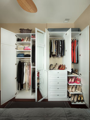 custom wardrobe built for a condominium bedroom with a jog in the wall