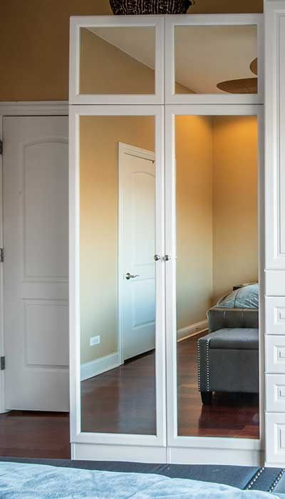 Wardrobe closet with closet mirrors on doors