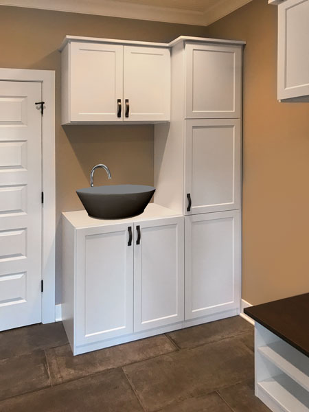 custom mud room storage with cabinets and sink