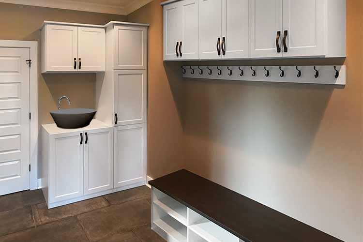 mudroom design idea with cabinet and hooks for jackets