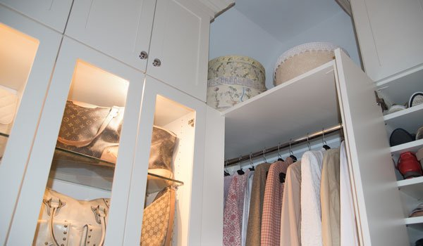 walk in closet with custom lighting