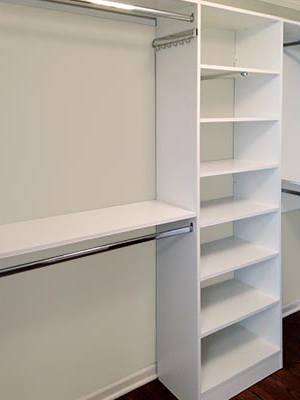 custom design for walk-in closet with shelves and pull-outs
