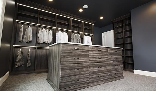 Custom closet and dressing room with elaborate walk in closet lighting system