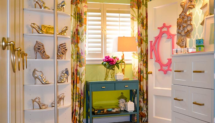 Small dressing room closet with shoe carousel in the corner