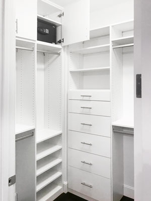 small walk in closet with security storage