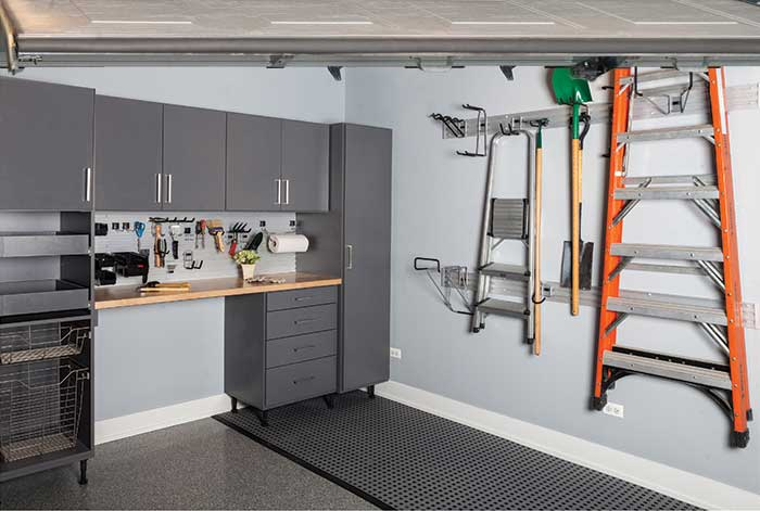 Custom  cabinetry for tool bench with wall track organization system
