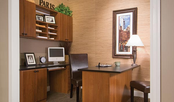 Home office organization system with custom desk, credenza and upper wall unit