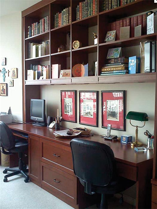 Home office organized around traditional home office design theme that features home office storage cabinets