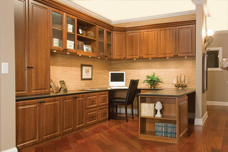 Chicago home office organization system with custom desk, cabinets in traditional style