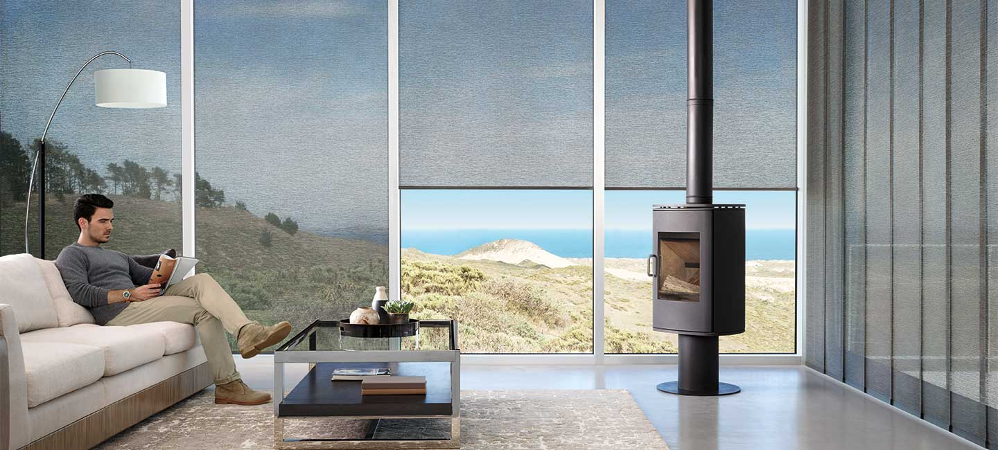 Window roller shades with premium fabric from the Alustra Woven Textures collection by Hunter Douglas