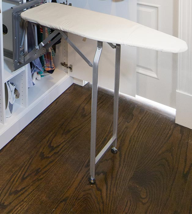 Fold-out ironing board for laundry room