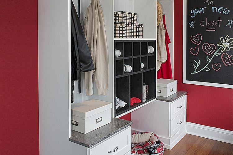 Custom designed mud room with storage for backpacks, shoes, coats, gloves