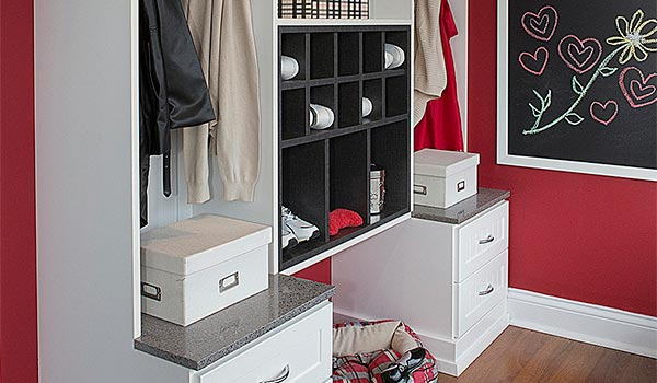 Dark red mudroom with white cabinetry