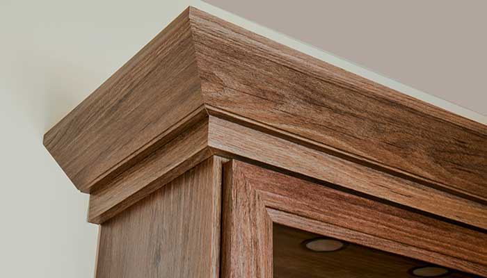 Detail of crown moulding on home theater cabinet