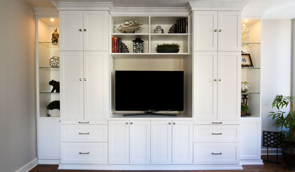 Multifunctional media center with custom lighting, glass shelves and pull-out work space