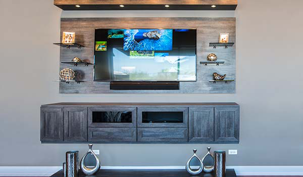Custom entertainment center with floating appearance for family room