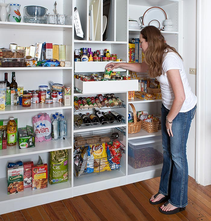 Custom reach in pantry shelving with drawers and organizers for spices, wine, trays