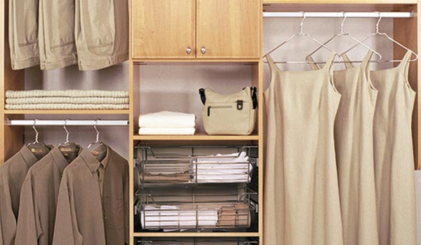 Closet built ins in light wood with basket storage