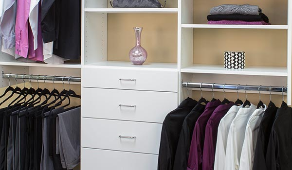 custom closet designs with 3 hanging rods, drawers and shelves
