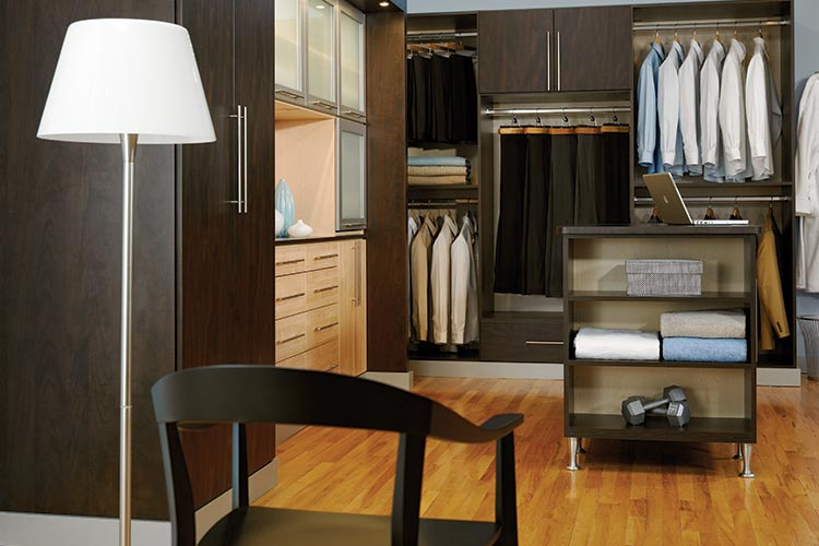 Walk in closet organization system in cocoa with maple accent fronts