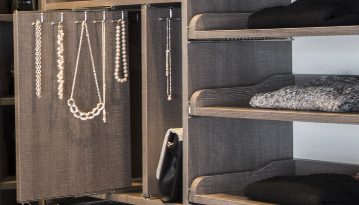 pull-out jewelry dividers and hooks add convenience to walk in closet systems