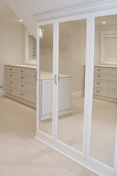 luxury closet ideas include a drawer system designed to mimic clothes dresser