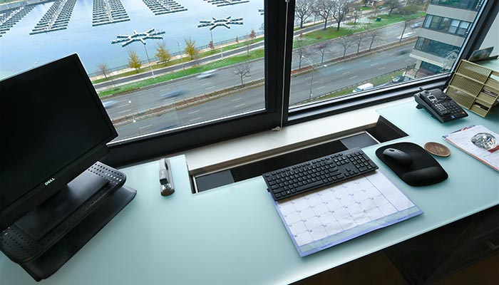 home office guest room includes glass desktop with cut out