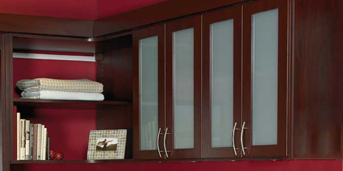 cabinet doors with frosted glass inserts add storage to MurphyBed system
